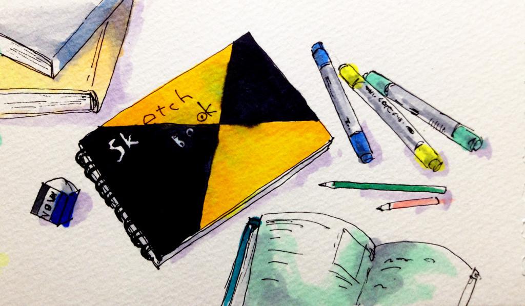 コピックや鉛筆でスケッチブックに読書の感想に関連するイラストを作成するイメージ