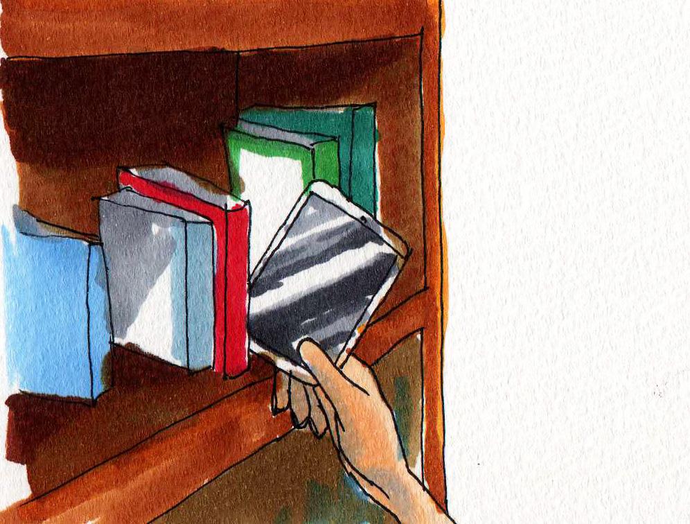 本棚から本を選ぶ